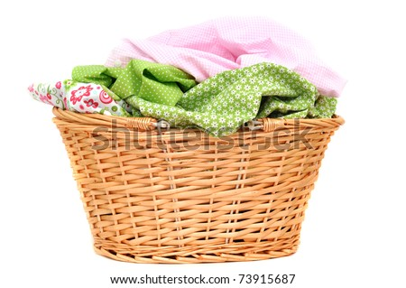 Laundry in a wicker basket, isolated on white