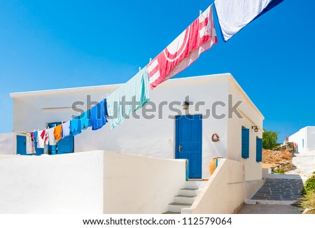 Laundry line with washed clothes outside a Greek island house in the Cyclades - stock photo