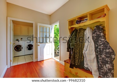 Laundry room with mud room and clothes. - stock photo