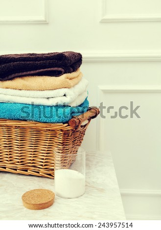 Laundry. Wicked basket with clean towels - stock photo