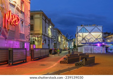 LAUSANNE, SWITZERLAND - JUNE 26: Night scene in the modern Flon district of Lausanne, Switzerland on the evening of June 26, 2014, after a long renovation process of the whole district. - stock photo