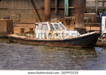 Lauwersoog harbor dock rusty ship  - stock photo