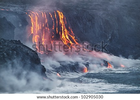 Lava erupting into Pacific Ocean in Hawaii Big Island - stock photo