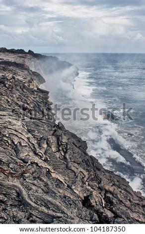 Lava erupting into Pacific Ocean in Hawaii Big Island - stock photo