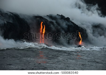 lava flow to pacific ocean at big island, hawaii