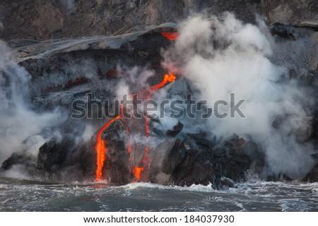 Lava flowing into Pacific Ocean on Big Island, Hawaii  - stock photo