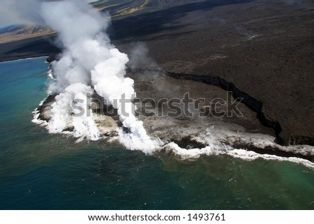 Lava from Kilauea Volcano flowing into the ocean cause a tremendous amount of toxic white smoke. - stock photo
