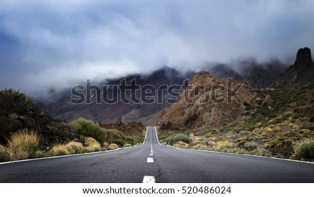 lava rocks and road in national park El Teide on canarian island of tenerife