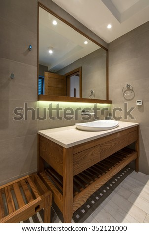 Lavatory and mirror in modern bathroom interior