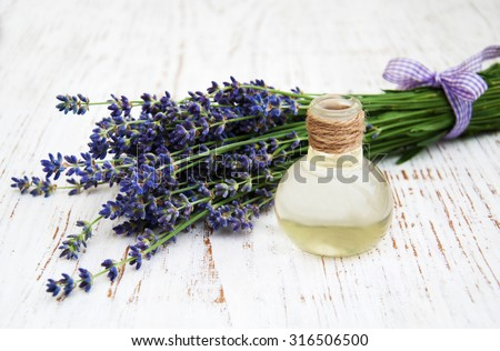 Lavender,and massage oil  on a old wooden background - stock photo
