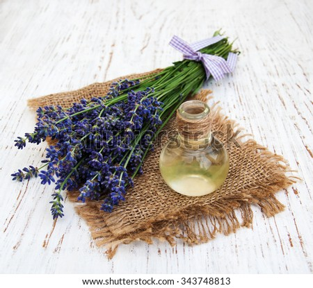 Lavender,and massage oil  on a old wooden background