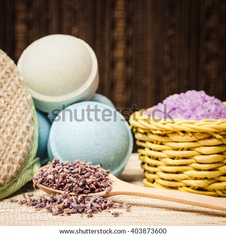 Lavender and organic bath cosmetic for beauty, aromatherapy, spa body care, relaxation, treatment. Herbal nature salt with herb, purple pant, flower. Natural aroma medicine. - stock photo