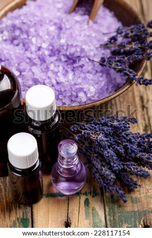 Lavender aromatherapy concept on wooden background - stock photo