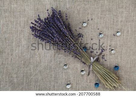 lavender bouquet on linen fabric with glass bead