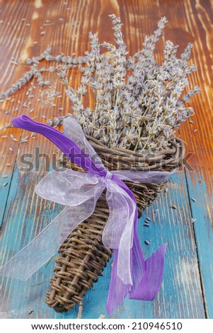 Lavender. Bunch of dried lavender  in wicker basket . Selective focus - stock photo