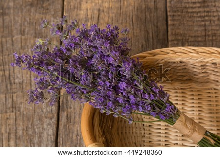 Lavender - bunch of lavender flowers on a wooden background