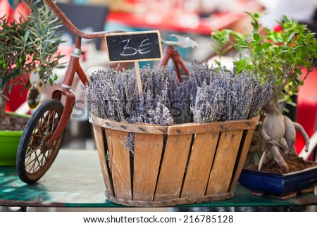 Lavender bunches selling in a outdoor french market. Horizontal shot with selective focus - stock photo