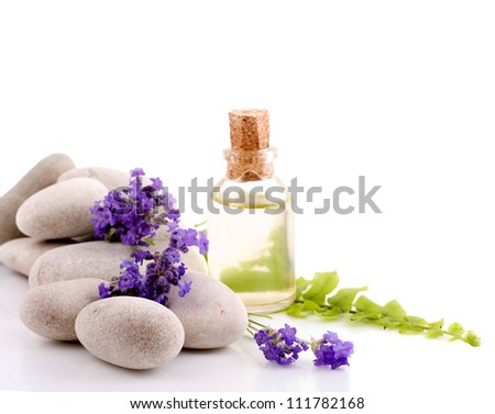 Lavender, essential oil and white stones - stock photo