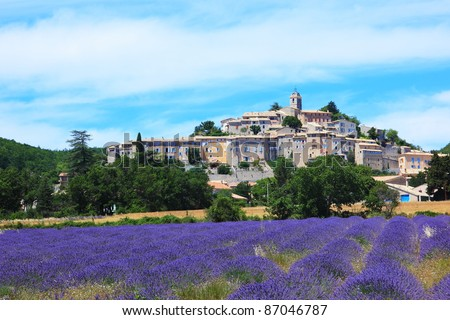 Lavender field and old village of Banon, France - stock photo