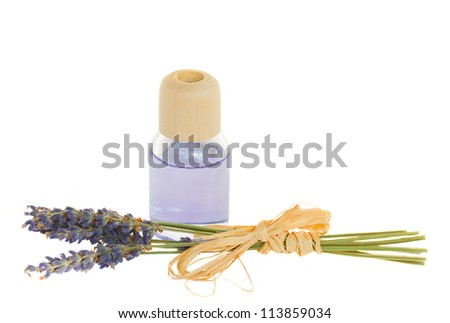 Lavender flowers and aroma oil isolated on white - stock photo