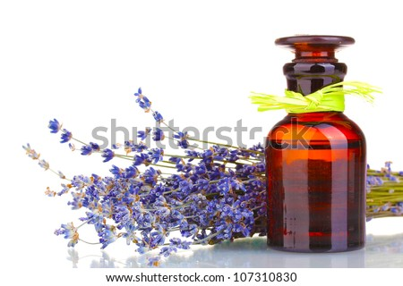 Lavender flowers and glass bottle isolated on white - stock photo