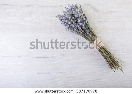 Lavender flowers in close up on wood background with space