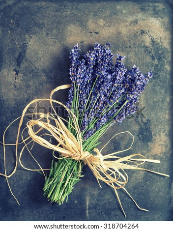 Lavender flowers with shabby chic decorations. Fresh blossoms. Vintage style toned picture - stock photo