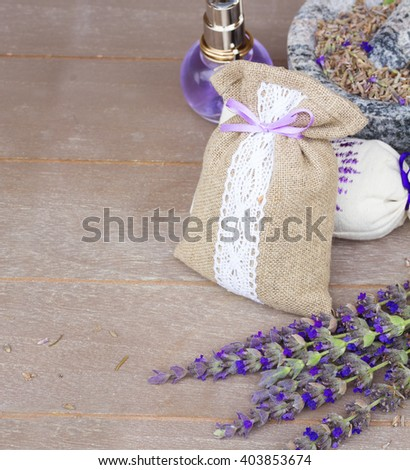 Lavender fresh flowers and dry in pouch border on wooden table with copy space - stock photo
