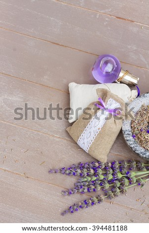 Lavender fresh flowers and dry in pouch on gray wooden table with copy space - stock photo