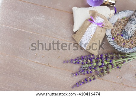 Lavender fresh flowers and dry in pouch on wooden table with copy space - stock photo