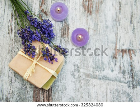 Lavender, handmade soap and  candles  on a wooden background - stock photo