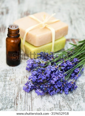 Lavender , handmade soap and massage oil on a old wooden background - stock photo