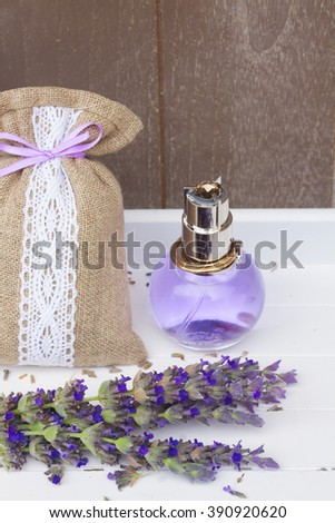Lavender herbal water, fresh blue flowers and dry in pouch - stock photo