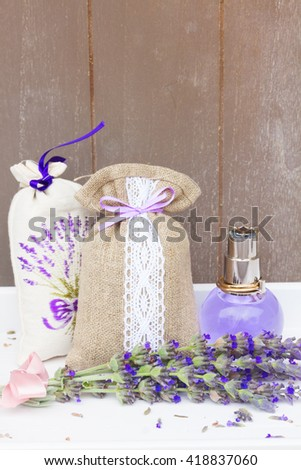 Lavender herbal  water, fresh flowers and dry in pouch - stock photo