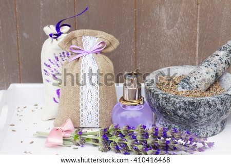 Lavender herbal water in a  bottle, fresh flowers and dry in mortar - stock photo