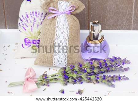 Lavender herbal water in a  bottle, fresh flowers posy and dry in pouches - stock photo