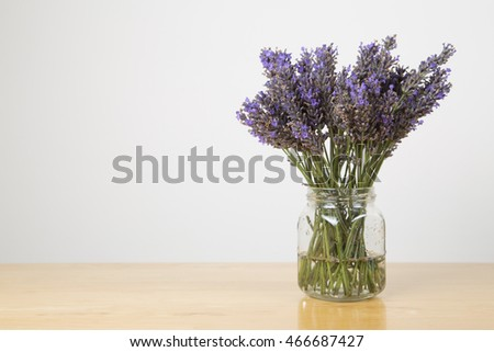 Lavender in a glass jar sitting on wooden table