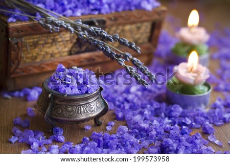 Lavender in vintage silver box, bath salt and candles on the wooden texture - stock photo