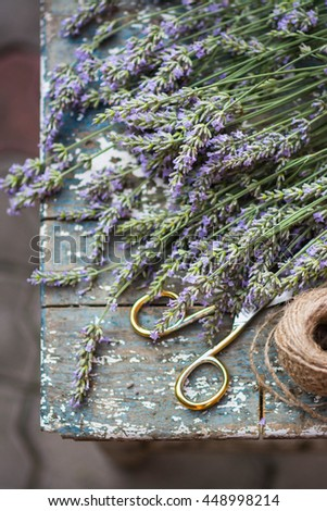 Lavender, lavender cutting, ribbon and vintage scissors fresh flowers on wooden rustic table. Aromatherapy. - stock photo