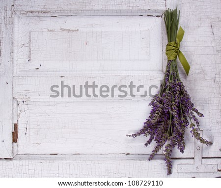 lavender laying on an old door panel, room for copy space - stock photo