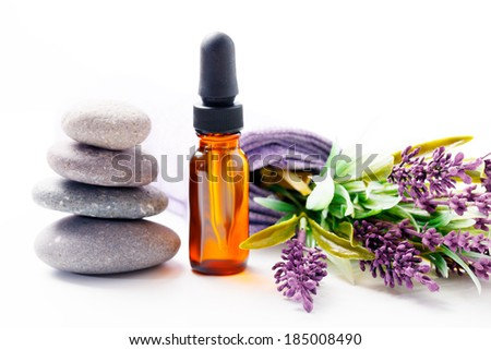 lavender oil and flowers - stock photo