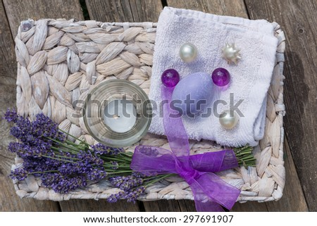 Lavender on a wooden board with a candle and soap