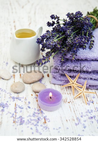 Lavender, sea salt and candle on a wooden background - stock photo