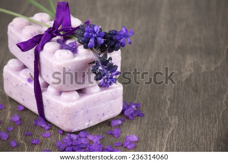 Lavender soap and bath salt on wooden background. - stock photo