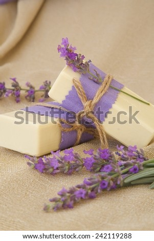 Lavender soap. Lavender twigs in the background. - stock photo