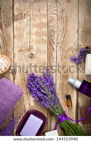 Lavender spa beauty treatment products on wooden table. Empty room for text. Top view - stock photo