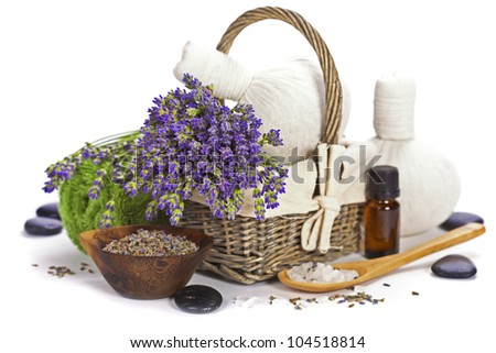lavender spa (fresh lavender flowers in a basket,  essential oil, salt,  Herbal massage balls, zen stones) over white - stock photo