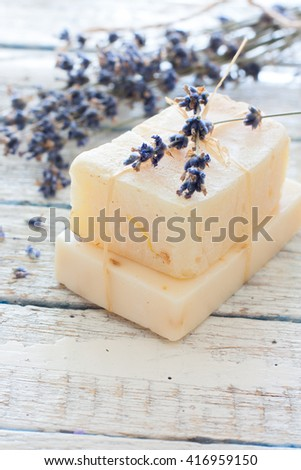 Lavender spa set with bar of soap, sea stars, lavender flowers and sea salt over white wood background