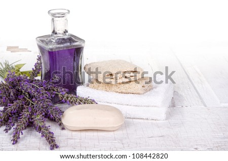 Lavender spa still life with soap, towels, and loofah - stock photo
