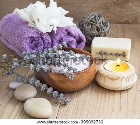 Lavender Spa Still Life with Towels, Sea Salt,Handmade Soap and Candle